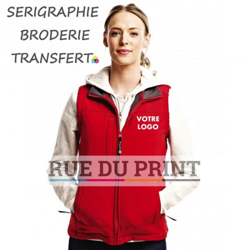 Bodywarmer publicité femme Softshell Ext: 96% polyester, 4% spandex int: 100% polyester (fleece) léger et souple, finition wat